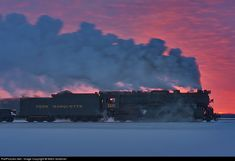 steam engine, with a full head of steam, sunset