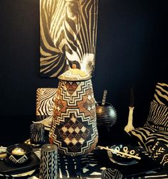 Elizabeth sent us this picture of one of her Zulu Ukhamba baskets as the centerpiece in a zebra print African display!