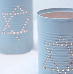 I saw this idea on the interwebs somewhere about making luminaries out of tin cans and I thought how perfect that would be for a Chanukah craft project. This Chanukah craft requires very little ski...