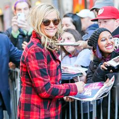 Star Tracks: Tuesday, October 28, 2014 | SEEING SIGNS | Amy Poehler is happy to sign pictures of her new book Yes Please outside the Late Show with David Letterman studios in New York on Monday.