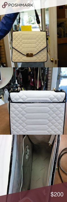 Brahmin crossbody purse white trimmed in black crossbody purse white trimmed in black with extra strap, excellent condition. Brahmin Bags Crossbody Bags