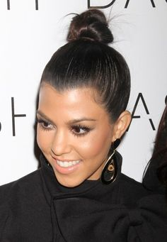 Kourtney Kardashian rocks a top knot