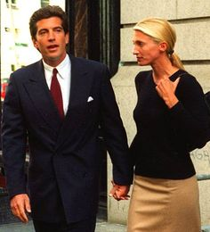 John F. Kennedy Jr., left, and his bride, Carolyn Bessette, leave their New York apartment Sunday, Oct. 6, 1996, the day after returning from their honeymoon in Turkey. This was the first time the couple has been seen together in public since their return.