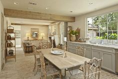French Country Kitchen with rustic wood beam.