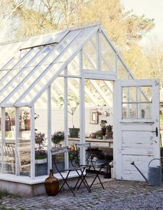 A guide to transforming your garden shed Rustic greenhouse and garden shed. Industrial style with outdoor seating and vases. More ways to revamp your garden shed at . Outdoor Rooms, Outdoor Gardens, Outdoor Living, Outdoor Seating, Garden Seating, Outdoor Decor, Greenhouse Shed, Greenhouse Gardening, Simple Greenhouse