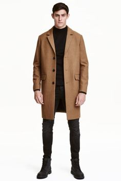 Wool-blend coat: Coat in a felted wool blend with notch lapels, buttons down the front, flap front pockets, one inner pocket and a single back vent. Lined. The wool content of the coat is recycled.