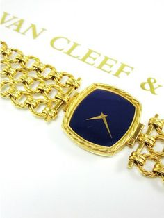 Stylish Van Cleef and Arpels tonneau shaped watch in 18 karat yellow gold and lapis lazuli- Vintage but absolutely timeless- The large size is pefectly in style today- circa 1970 - a full 7inches long by approximately 1 1/4 inches wide- Stunning