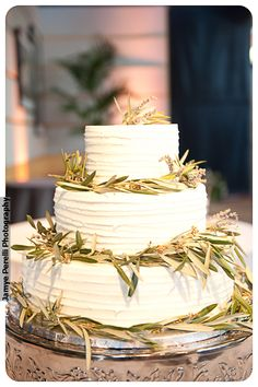 Beautiful wedding cake by Tart Bakery Dallas. Comb texture with olive branch and lavender