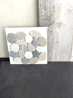 Faro Ceniza porcelain tile with warm tone flat pebble by Arizona tile.
