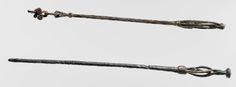 Two seeress's magic staffs. The shorter one is from the Gävle area of Sweden and the longer from a grave at Fuldby, near Ringsted in Denmark. Photo credit - National Museum of Denmark  (These look like distaffs to me....)