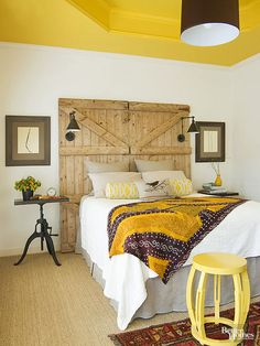 Hints of exposed wood -- especially those with a prominent grain -- always feel at home in autumn. The warm tone of the wood itself, coupled with the raw texture, creates a rustic and inviting look no matter how it's displayed. Add in touches of seasonal color, like this quince yellow, and the space is quintessentially fall./