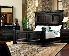 love the high headboard, dark warm color, poster footboard style
