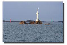 """Lighthouses of Iroise. Phare des Trois Pierres  à Molène. Le feu des Trois Pierres est situé au nord-est de l'île. C'est une colonne blanche de 16 mètres de hauteur. Ses coordonnées géographiques sont: 48º 24' 7"""" N 04º 56' 8"""" W.   Photo Gilles Dhordain.  Finistere"""