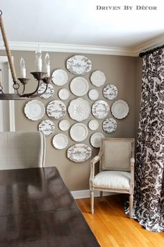 White plates mixed with brown Isis? transferware on a lovely buff walls.
