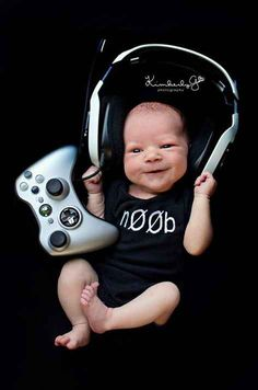 And this tiny gamer guy: My baby is so cute and my photographer is SUPER awese and talented!!! Kimberlygphotography.com