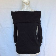 Express // Off the Shoulder Sweater - black This off the shoulder of cowl neck sweater is longer than most sweaters, it sits just below the hips. It is great to wear with leggings and a cute vest for the in between days. Never been worn, only tried on. 3/4th length sleeves, ribbing on the sides of torso and turtle neck. 55% cotton, 35% rayon, and 7% nylon. Express Sweaters Cowl & Turtlenecks