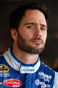 Jimmie Johnson, driver of the #48 MyLowe's Chevrolet, stands in the garage area during practice for the NASCAR Sprint Cup Series Goody's Fast Relief 500 at Martinsville Speedway on March 30, 2012 in Martinsville, Virginia.