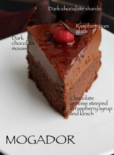 Mogador - Chocolate genoise steeped in raspberry syrup and Kirsch, topped with dark chocolate mousse and raspberry jam.