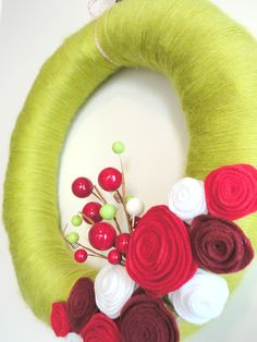 Lime with red and burgundy felt flowers Christmas yarn wreath.