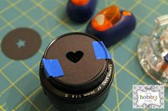 Get lovely shaped bokeh in your photos with black paper and a paper punch--the possibilities are endless!