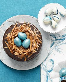 Tucked inside nests of milk-chocolate shavings are truffle eggs tinted robin's egg blue and dusted with metallic luster. The accompanying marbled eggs are created by dipping more truffles into melted white chocolate swirled with blue food coloring.