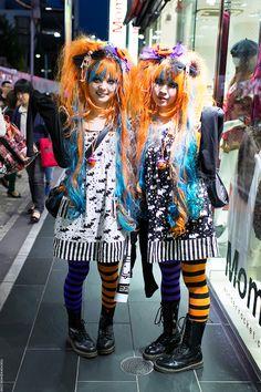 Harajuku girls in matching Halloween-inspired outfits snapped at night on Takeshita Dori.
