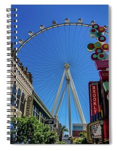 """This 6"""" x 8"""" spiral notebook features the artwork """"Linq Promenade - High Roller Ferris Wheel - Las Vegas"""" by Debra Martz on the cover and includes 120 lined pages for your notes and greatest thoughts."""