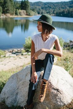 White distressed top + green hat + lace-up brown boots