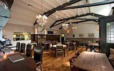 Fox & Grapes - a gastro pub on Wimbledon Common.  Don't think the lights work in this setting but aircraft hanger style might work although acoustics?  I hate not being able to hear dinner companions because of bad accoustics...