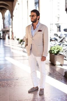 Biege tan off white suit blazer jacket with white chinos and suede loafers for summer wedding suit