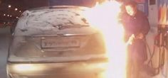 Woman sets her car on fire at gas station in Russia