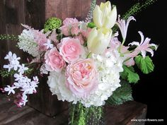 wedding reception centerpiece in pink and blush flowers in clear hobnail vase by Sprout Flowers Worcester MA