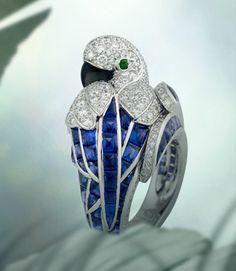 Ring, platinum, sapphires, emerald eyes, mother of pearl beak, brilliant cut diamonds