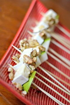 Bite-sized brie and pear skewers with toasted walnuts and honey using ingredients from ALDI. Perfect for holiday entertaining.