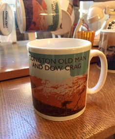 Coniston Old Man - The Lake District National Park  A Northern Line Mug created from an original graphic poster designed in The Northern Line studio in Ulverston, Cumbria. We ship worldwide.