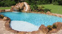 pictures of pools with waterfall slides | Lagoon Pool with Custom Rock Slide and Waterfall