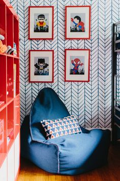 "We can't stop ""marvel-ing"" at this adorable ""heroes"" corner! W/ bold wallpaper, cute graphic art, & a comfy place to sit, this reading corner is perf for any ""hero-to-be."""