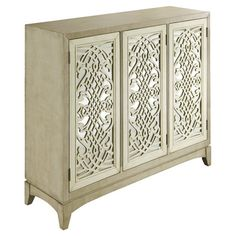Display a vase of lush blooms or a stack of leather-bound tomes atop this lovely sideboard, featuring mirrored doors with a scrollwork overlay.   ...
