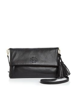 A fold over, flap front silhouette accented with chic tassels, this Tory Burch crossbody delivers both weekend-perfect ease of wear and timeless polish. | Leather | Imported | Detachable adjustable cr