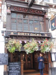 Dirty Dick's Pub, Bishopsgate, London. Nathaniel Bentley the owner of the warehouse tragically lost his fiance a night before his wedding, heartbroken he shut up the warehouse and never washed again, all letters were addressed to The Dirty Place, London. It became a tourist attraction and his clothes were pinned to the ceiling, later it become the pub hence the name, Dirty Dicks