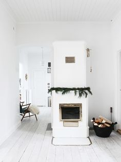 simple christmas decorations - a bit of green, fire logs in a basket, cozy faux fur throws and gold accents