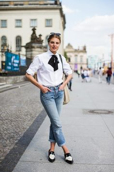 White blouse with a black bow, jeans, loafers.| @andwhatelse