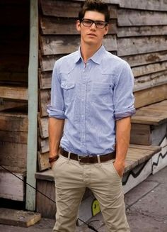 Wear a grey chambray long sleeve shirt with beige chinos for a Sunday lunch with friends.