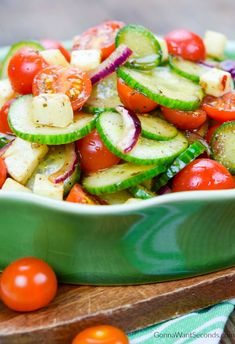 Cool off with my Cucumber Tomato Salad, a crisp, colorful, refreshing side with salty bits of mozzarella and a rich, tangy balsamic vinaigrette.  A delicious dish full of garden delights!