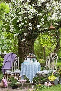 Tea under the blooming flowers. L.O.V.E