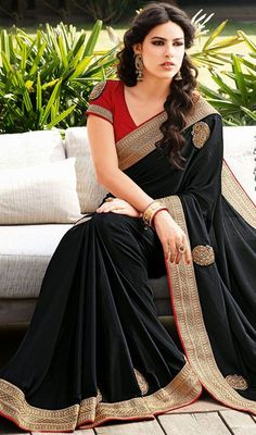 Acquire a twist of urban elegance this black chiffon saree. The appealing lace, resham and stones work all through saree is awe-inspiring. Comes with a matching stitched round neck blouse with 6 inches sleeves. Chiffon Saree, Saree Dress, Cotton Saree, Beauty And Fashion, Asian Fashion, India Fashion, Indian Dresses, Indian Outfits, Indian Clothes