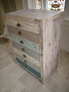 loft style beach house wooden cabinet this pretty multi coloured wood cabinet with its sun bleached finish is very on trend with distressed painted finish