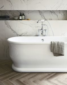 Beautiful free standing tub with built in ledge in the marble.