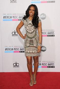 We loved Kelly Rowland's outfit last night at the American Music Awards!    She was dressed in Naeem Khan mosaic-style fitted dress, with lots of jewels and gems! This gown was part of his fall 2012 collection.     She looked so stunning!