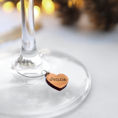 A set of 10 lovely wooden heart shaped wine glass charms, personalised with your guests names. These wooden wine glass charms are carefully handmade for you in our Brighton studio. The wooden hearts are laser cut from reclaimed alder wood, and the name is laser etched onto the